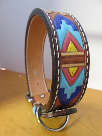 Tribal themed tooled leather dog collar shown.
